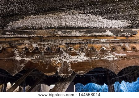 Salt on wooden elements in Salina Turda salt mine in Turda city in Romania