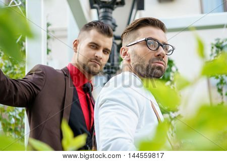Two stylish young caucasian guy outdoors