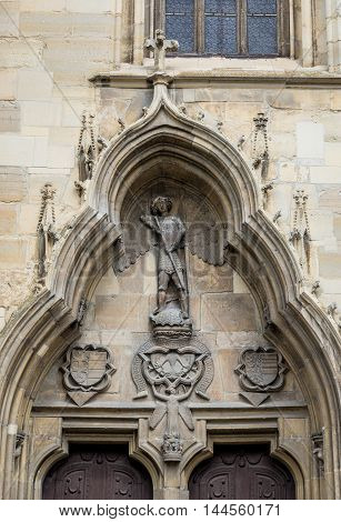 Details of carved entrance to St. Michael's Church in Cluj-Napoca city in Romania