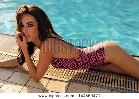 Gorgeous Woman With Dark Hair In Elegant Swimsuit