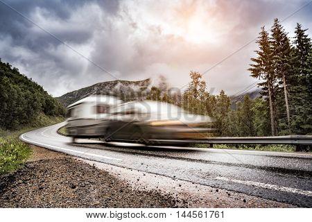 Caravan car trailer travels on the highway. Caravan Car in motion blur.