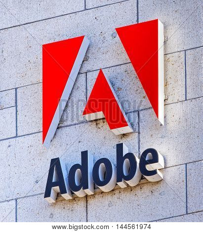 Basel, Switzerland - 27 August, 2016: Adobe sign on the wall of an office building. Adobe Systems Incorporated is an American multinational computer software company headquartered in San Jose California.