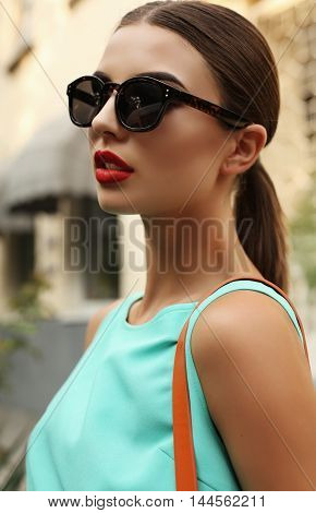 Beautiful Young Woman With Dark Hair With Sunglasses