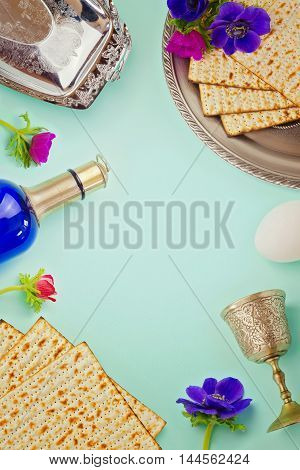 Passover background with matzo wine and flowers. Jewish holiday celebration