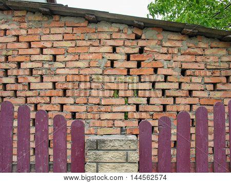 The building of the wall  built of brick masonry rough way