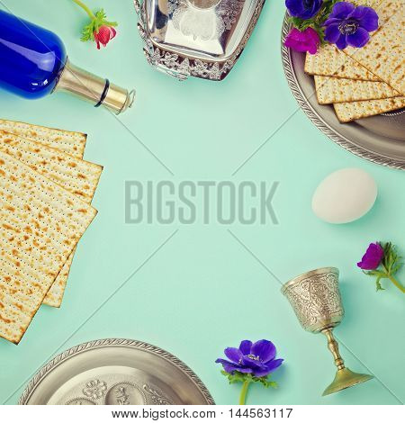 Jewish holiday Passover background with matzo wine and flowers