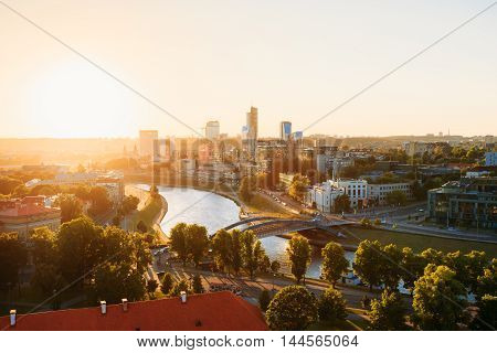 Sunset Sunrise Cityscape Of Vilnius, Lithuania In Summer. Beautiful View Of Modern Center In Evening. View From The Hill Of Upper Castle. Good Weather, With Sunshine Sky