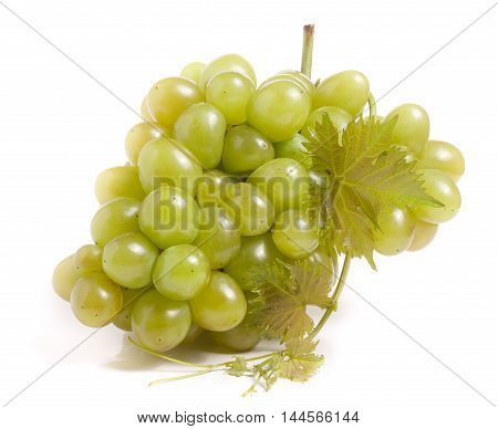 bunch of green grapes with leaf isolated on white background.