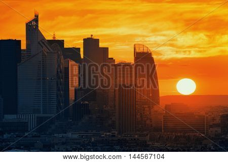Paris sunset rooftop sunset view of the city skyline with la Defense business district in France.