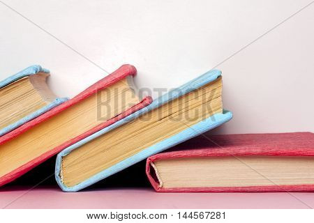 Composition with vintage old hardback books diary fanned pages on light background. Books stacking. Back to school. Copy Space. Education background.