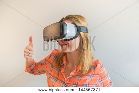 Young girl in a virtual reality headset. For modern design projects.