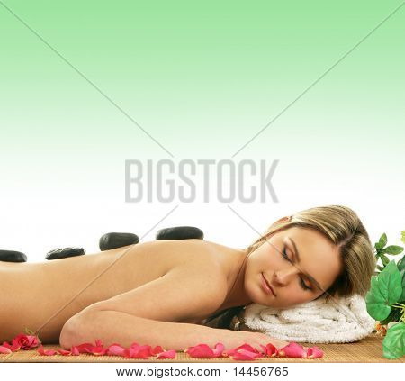 Young sexy woman getting spa treatment over green background