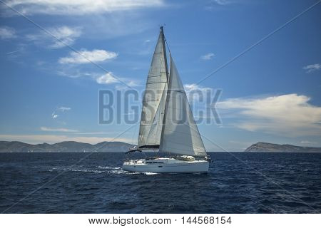 Sailing ship luxury yacht with white sails in the Aegean Sea.