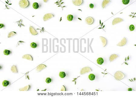 lime and green branches frame on white background. flat lay top view