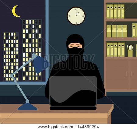 a thief in the night the office with a laptop. Hacker trying to enter the password