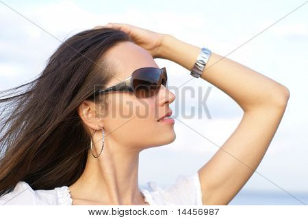 Attractive woman over sky background