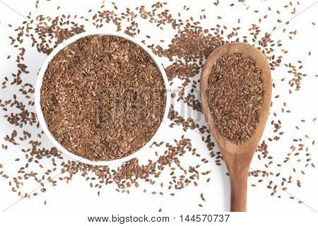 linseed into a bowl in white background