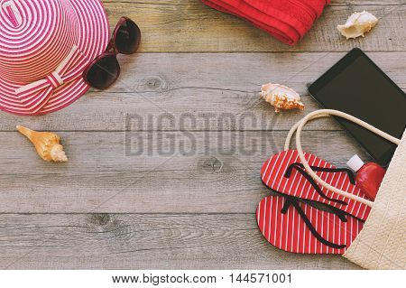 Summer holiday background with beach items and digital tablet. View from above
