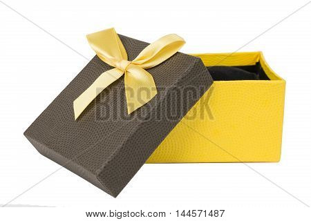 yellow and brown Gift box with ribbon on white isolated background