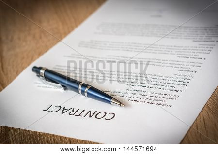 Pen And Contract Paper