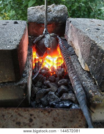 Hot coals in the forge. Making metal flower