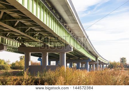 Perspective view of an overpass from below.