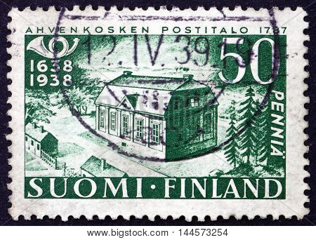 FINLAND - CIRCA 1938: a stamp printed in Finland shows Early Post Office 300th Anniversary of the Finnish Postal System circa 1938
