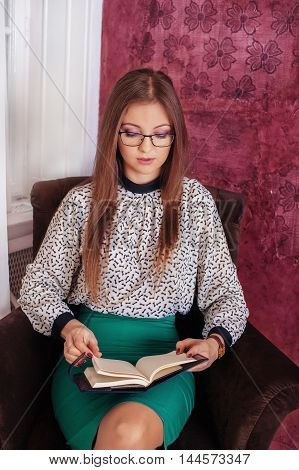 intelligent woman reading notes. The concept of lifestyle