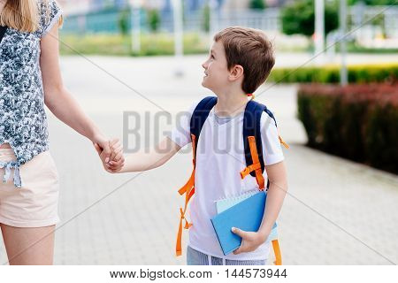 Boy With His Mother At Road To School.