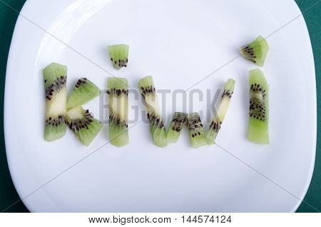 Top View On Letters Made Up Of Pieces Of Kiwi