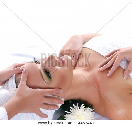 Young attractive sexy blond getting spa treatment isolated on white background