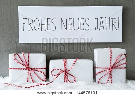 Label With German Text Frohes Neues Jahr Means Happy New Year. Three Christmas Gifts Or Presents On Snow. Cement Wall As Background. Modern And Urban Style. Card For Birthday Or Seasons Greetings.