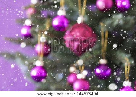 Blurry Christmas Tree With Rose Quartz Balls. Close Up Or Macro View With Snowflakes. Christmas Card For Seasons Greetings.