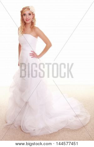 Wedding day. Full length young attractive romantic bride in white dress isolated on white background