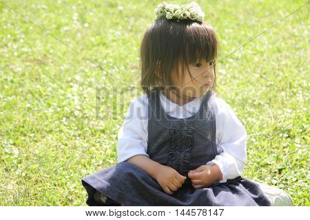 Japanese girl with a chaplet (1 year old)