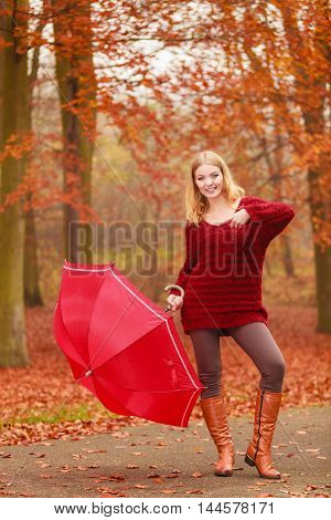 Fashion Woman With Umbrella Relaxing In Fall Park.