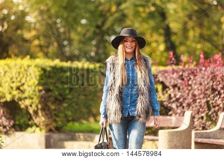 Fashionable Model Posing In Park