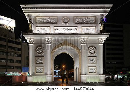 SKOPJE MACEDONIA - SEPTEMBER 16: Macedonia Gate in Skopje on SEPTEMBER 16 2012. Macedonia Gate Marble Arch Monument at Night in Skopje Macedonia.