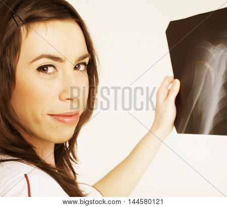 young pretty real woman doctor with stethoscope close up