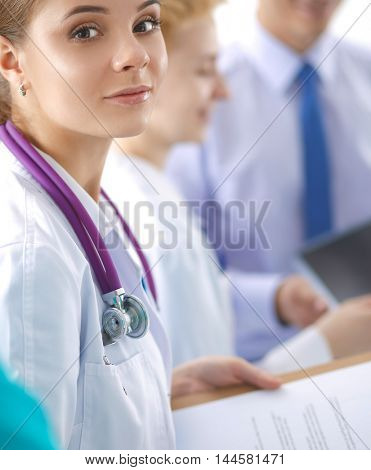 Attractive female doctor in front of medical group