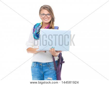 Smiling teenager with laptop on white background