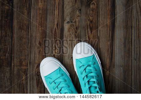 shoes on empty wooden floor