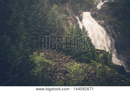 Mountain Waterfall Place. Scenic Mountain Landscape with Waterfall in the Norway.