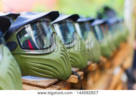 Paintball mask, boy extrime sport game. Summer