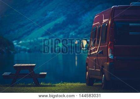 RV Camping at Night. Small Camper Van Overnight Camping.