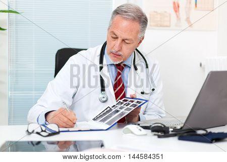 Senior doctor working in his studio