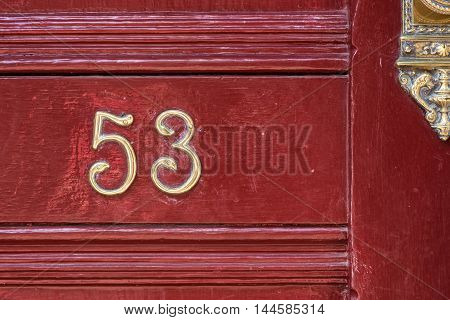 Number fifty three in a red door
