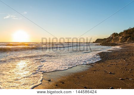 Ocean shore at sunset (Cabot Trail Cape Breton Nova Scotia Canada)