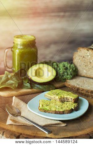 Healthy breakfast: green juice and avocado toast