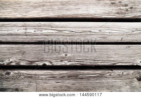 Old worn wood planks textured background. Gray weathered wooden table backdrop
